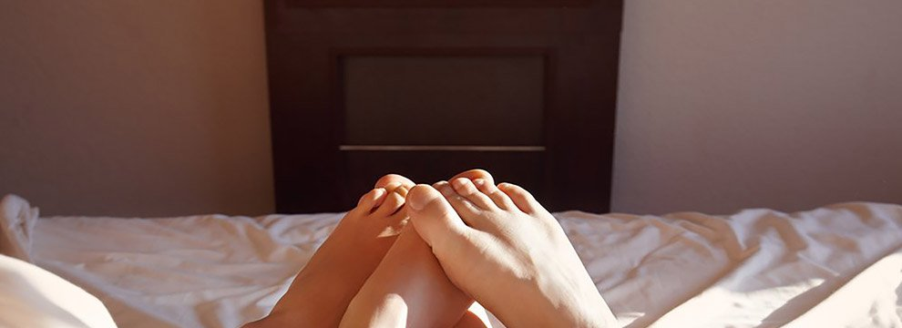 couple on bed toes visible